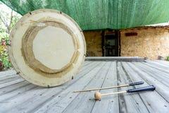 The janggu or janggo Traditional Korean drum with beating Sticks on the wooden table. The janggu or janggo or sometimes called seyogo means slim waist drum is stock photos