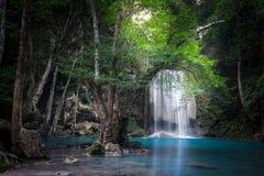 Jangle landscape with Erawan waterfall. Kanchanaburi, Thailand. Jangle landscape with flowing turquoise water of Erawan cascade waterfall at deep tropical rain Stock Photo