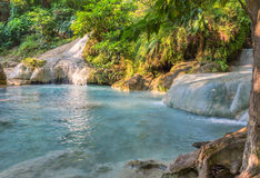 Jangle landscape with flowing turquoise water of Erawan Stock Photo