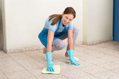 Janitor Cleaning Floor With Rag Stock Photography