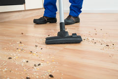 Janitor Cleaning Floor With Vacuum Cleaner Royalty Free Stock Photo
