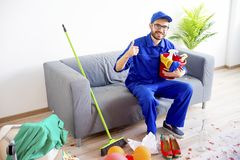 Janitor cleaning a mess. A janitor is cleaning a mess after a party Royalty Free Stock Photography