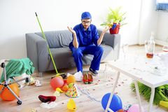 Janitor cleaning a mess Royalty Free Stock Photos