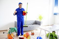Janitor cleaning a mess. A janitor is cleaning a mess after a party Royalty Free Stock Photos