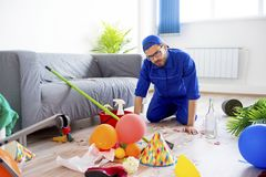 Janitor cleaning a mess Royalty Free Stock Photography