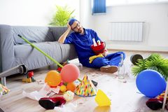 Janitor cleaning a mess Stock Image