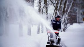 The janitor clears the track with a snowplow in the courtyard of an apartment building. Moscow stock footage