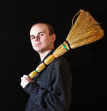 Janitor man with besom on black Royalty Free Stock Images