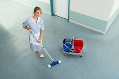 Janitor with mop and cleaning equipment Stock Photos
