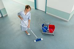Janitor with mop and cleaning equipment Stock Photo