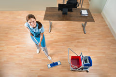 Janitor Mopping Floor In Office Stock Photography