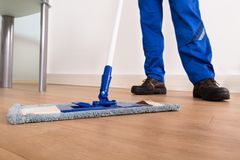Janitor mopping. Low Section Of A Janitor Mopping Floor Stock Photography