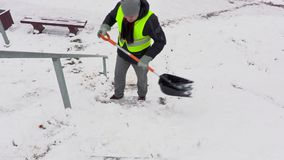 Janitor with snow shovel cleaning stairs stock video