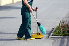 Janitor sweeping broom street Stock Photography