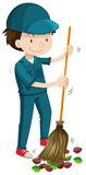 Janitor sweeping the fallen leaves Stock Photos