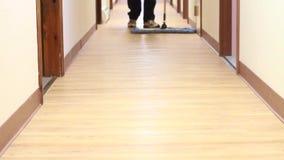 Janitor sweeping floor stock video footage