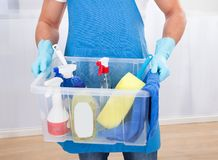 Janitor with a tub of cleaning supplies Stock Photography