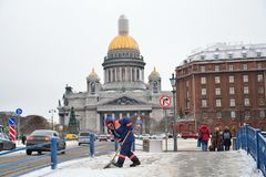 Janitor worker removes snow in the centre of Saint-Petersburg Royalty Free Stock Photography