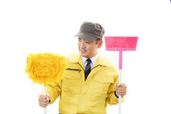 Janitorial cleaning service. The male worker who poses happily on white background Stock Photos