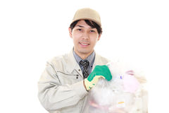 Janitorial cleaning service. Smiling Asian worker isolated on white background Stock Image
