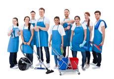 Μεγάλη διαφορετική ομάδα janitors με τον εξοπλισμό Στοκ Εικόνες