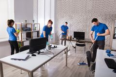 Free Janitors Cleaning The Office Stock Photo - 103309220