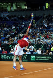 Janko Tipsarevic-11. BELGRADE-SEPTEMBER 13:Player J.Tipsarevic(SRB) served a ball during a match against M.Raonic(CDN) during semifinal Davis Cup Serbia-Canada.M Stock Photo