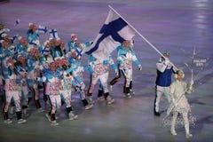 Janne Ahonyen, der die Flagge von Finnland die finnische Olympiamannschaft beim PyeongChang führend 2018 Winterolympiade trägt Lizenzfreies Stockfoto