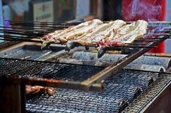 Janpanese people cooking Unagi (eel) or kabayaki or Grilled eels stock photos