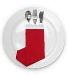 Jantar de Natal, guardanapo dobrado como botas de um Papai Noel Foto de Stock Royalty Free