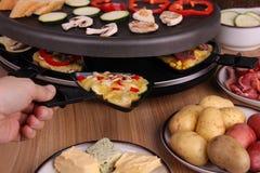 Jantar de Raclette Foto de Stock Royalty Free