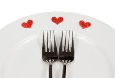 Jantar do dia de são valentim ao restaurante no fundo branco Imagem de Stock Royalty Free