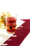 Jantar do Natal com vela vermelha Fotos de Stock Royalty Free