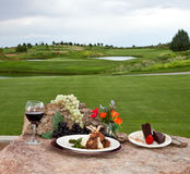 Jantar no campo de golfe fotografia de stock royalty free