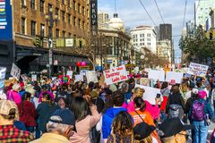 January 19, 2019 San Francisco / CA / USA - Participants to the Women`s March event hold signs with various messages