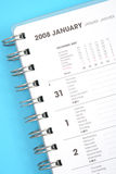 January 2008. Close-ups of year planner on blue background Royalty Free Stock Photo