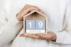 January 19 in the calendar. the girl is holding a wooden calendar. Robert Lee's birthday.  Royalty Free Stock Photos