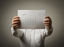 January calendar list of the year two thousand sixteen. Man is holding January calendar of the year two thousand sixteen royalty free stock images