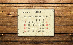 January 2014. Calendar of January 2014 on the wooden background Royalty Free Stock Photo