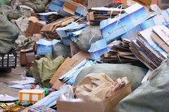January 24, 2019. China, Suifenhe. Cardboard boxes and garbage bags piled in a big pile stock photos