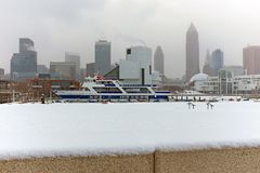 Snow flies across the Cleveland Ohio skyline during a January storm. January, the coldest month for Ohio, in downtown Cleveland Ohio includes cold weather royalty free stock photography