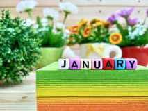 January. Colorful cube letters on sticky note block. stock photography