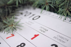 January, first, 2010. Calendar with date January, first, 2010 against fur-tree branches Royalty Free Stock Photography