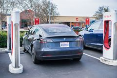 January 15, 2018 Gilroy / CA / USA - The new Tesla Model 3 stopped at a supercharger station located in south San Francisco bay. Area stock photos