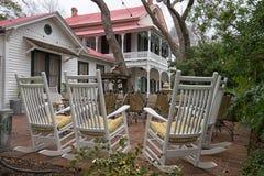 Rocking chairs on patio in Gruene Texas Stock Photo