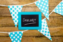 January - handwritten in chalk on framed backboard against blue Royalty Free Stock Photography