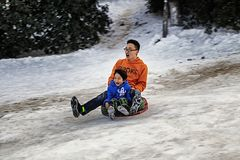 Father and son skiing together outdoors Stock Image