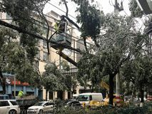 Maintenance repair by ice collapse line. In January 28, 2018, Jiangxi Nanchang was freezing rain invasion caused by secondary disasters, such as trees, collapse Stock Image
