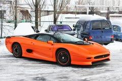 January 3, 2013; Kiev, Ukraine. Jaguar XJ220 on winter road royalty free stock photography