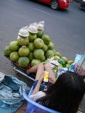 03 january 2017 Long Nget Street 250 phnom penh cambodia, young fruit sales woman playing game on smartphone editorial Stock Photos